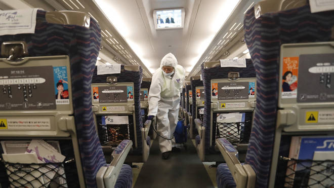 A worker disinfectants a train as a precaution against the coronavirus at Suseo Station in Seoul, South Korea
