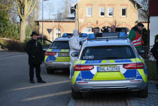 Police at the scene where six people were shot dead in Germany