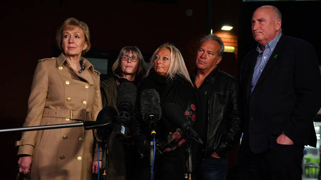 Business Secretary Andrea Leadsom (left), Harry Dunn's mother Charlotte Charles (centre), his stepfather Bruce Charles (second right) and family spokesperson Radd Seiger (right)