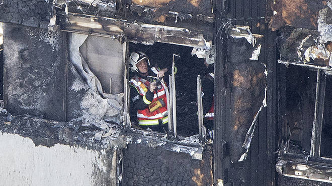 Firefighter working in burning Grenfell Tower