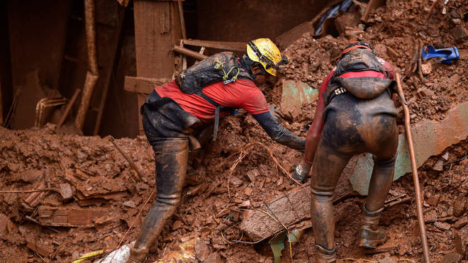 Rescue workers looking for victims in Vila Bernadete, Belo Horizonte