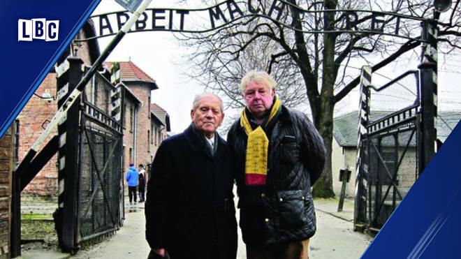 Nick Ferrari with Arek Hersh outside the gates of Auschwitz