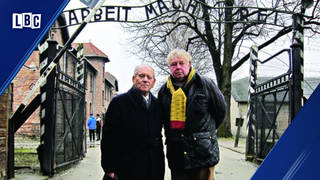 Nick Ferrari with Arek Hersh outside the gates of Auschwitz