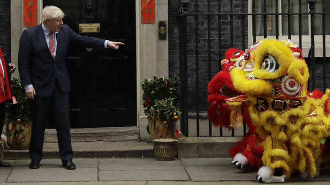Boris Johnson points at performers dressed as lions as he welcomes members of the British Chinese community for Chinese New Year celebrations last week