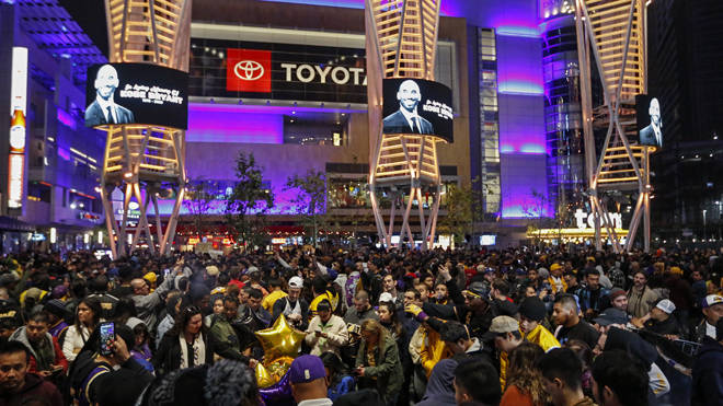 Mourners gather outside the Staples Center in LA