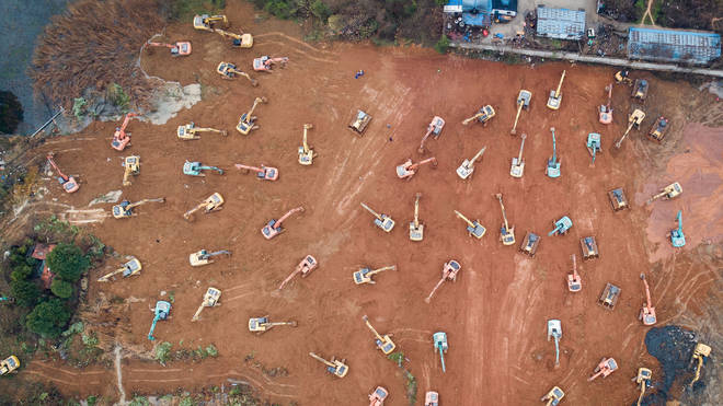 Diggers working at the hospital construction site in the west of Wuhan