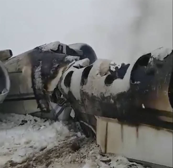 This photo provided by Tariq Ghazniwal shows an aircraft that crashed in eastern Afghanistan