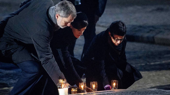 King Felipe and Queen Letizia of Spain lay a candle at the monument in Camp Birkenau during the the 75 years commemoration