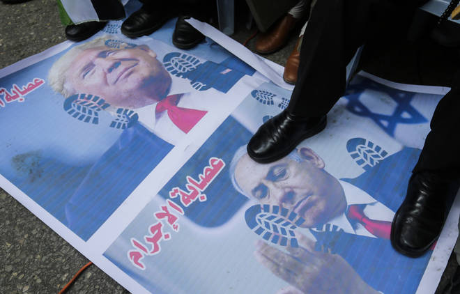 Palestinian protesters stamped on pictures of Trump and Netanyahu