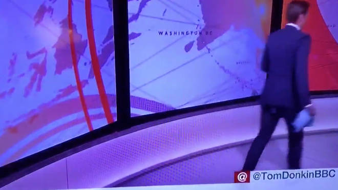 Newsreader Tom Donkin runs to face a different camera