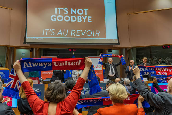 """MEPs raised flags in the Parliament labelled """"Always United"""""""