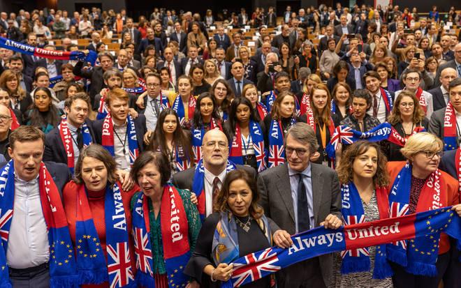 "Some MEPs held up scarves labelled ""Always United"""
