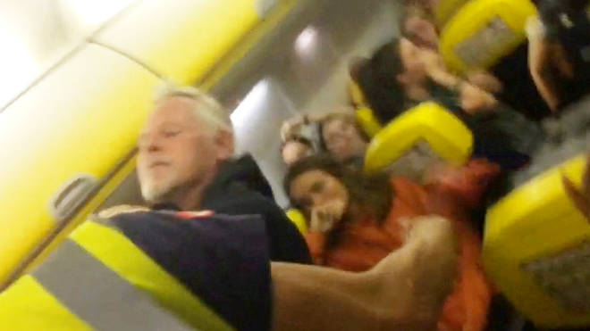 """Have-a-go hero puts """"drunk"""" passenger in a chokehold."""