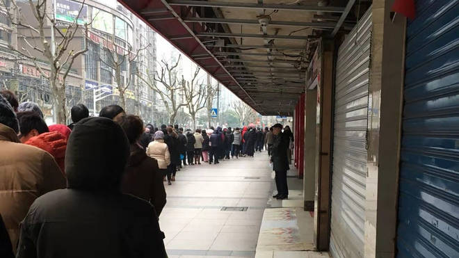 A queue outside a shop in Shanghai on Wednesday