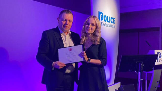 Lissie Harper and Police Federation Chair John Apter