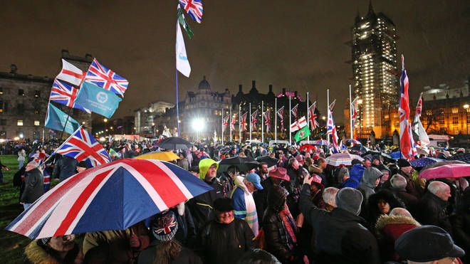 People gather to bring in Brexit in Parliament Square