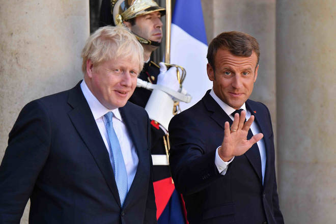 r Macron pictured with UK Prime Minister Boris Johnson