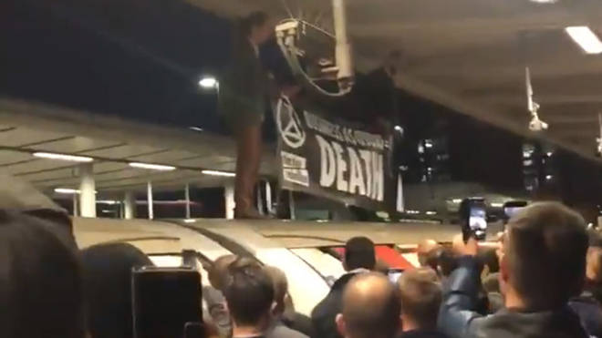 Angry commuters turned on XR protesters at Canning Town after they held up their train