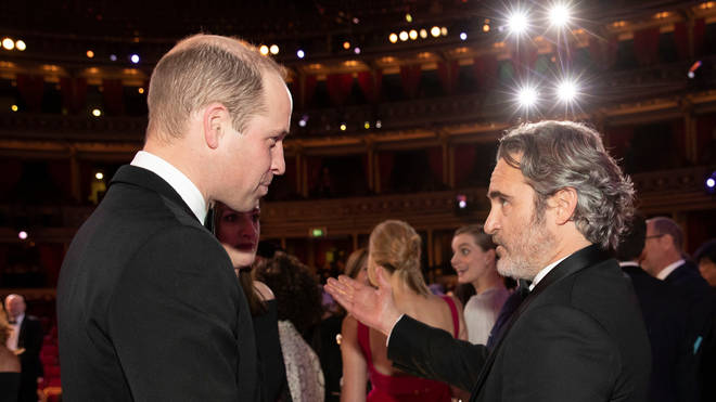 The Duke of Cambridge (left) talks to Joaquin Phoenix during the EE British Academy Film Awards at Royal Albert Hall