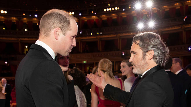 The Duke of Cambridge (left) talks to Joaquin Phoenix during the EE British Academy Film Awards at Royal Albert Hall