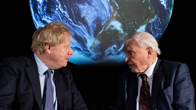 Boris Johnson, left, talks with David Attenborough during the COP 26 launch