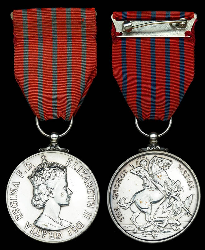 Mr Russell was handed the George Medal by the Queen