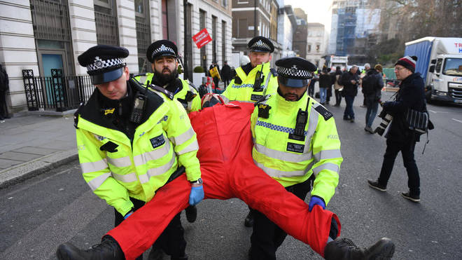 Police have begun removing the activists blocking BP's entrances