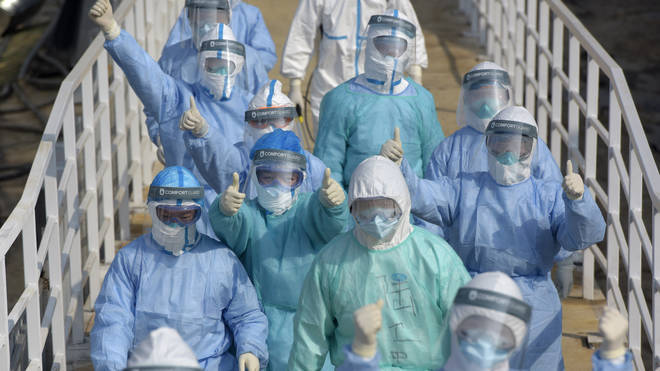 Chinese medical personnel have been seen wearing protective gear