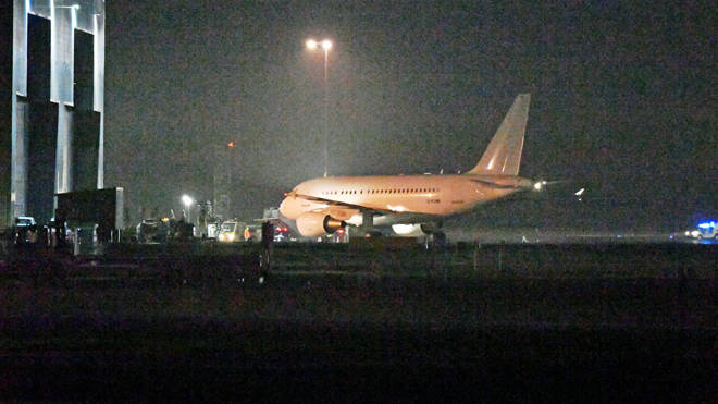 A plane brings British nationals back to the UK from the coronavirus-hit city of Wuhan on Sunday