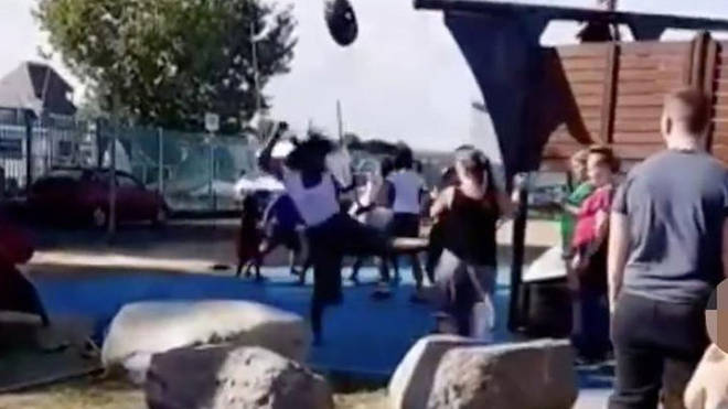 The brawl erupted at a playground in Kent on Monday afternoon
