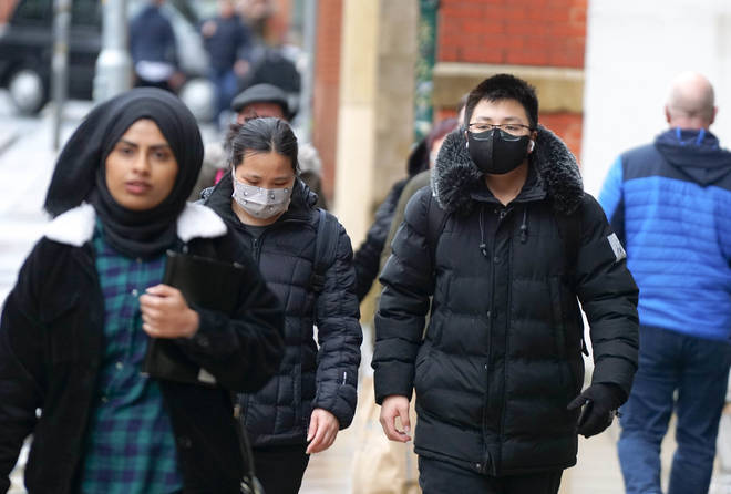 People wearing face masks in Manchester amid the coronavirus outbreak