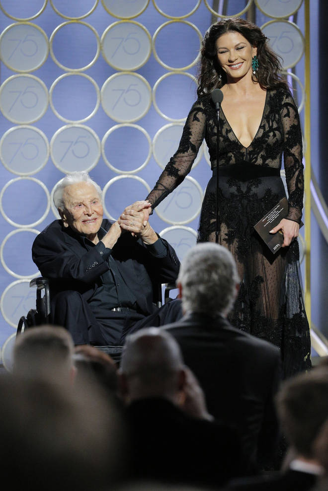Kirk Douglas and Catherine Zeta-Jones present during the 75th Golden Globe Awards in 2018