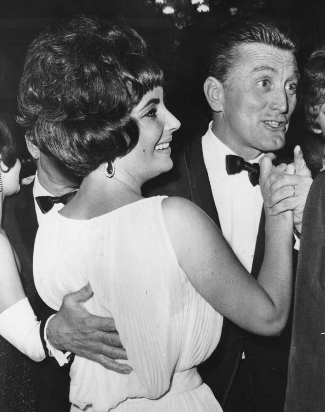 Elizabeth Taylor dancing with Kirk Douglas at the party in Rome for the film 'Spartacus'