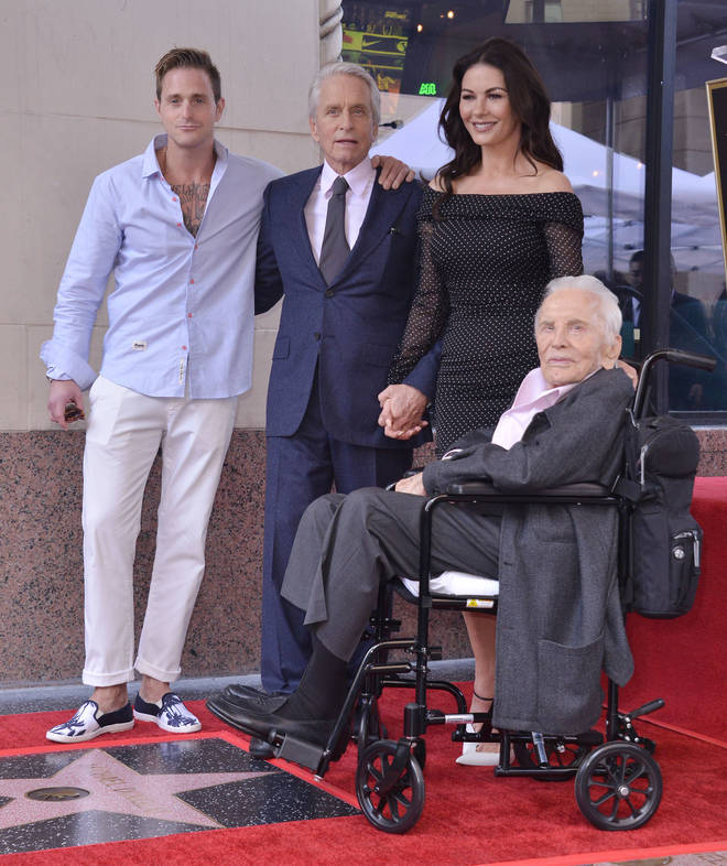 Kirk pictured with son Micheal, grandson Cameron and daughter-in-law Catherine Zeta-Jones at Micheal's Walk of Fame ceremony