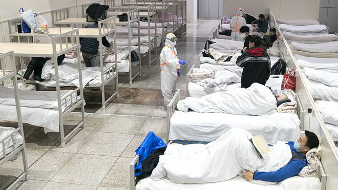 Patients infected with the novel coronavirus are seen at a makeshift hospital converted from an exhibition center in Wuhan