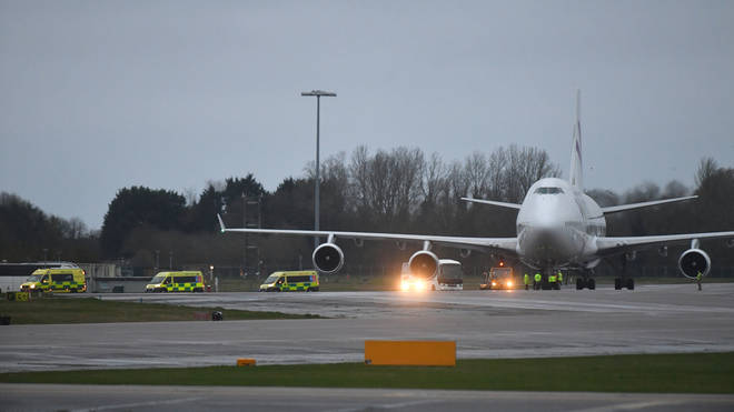 Ambulances wait for passengers at RAF Brize Norton