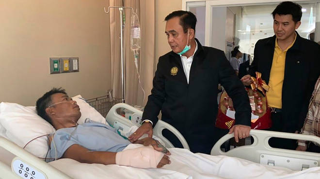 Thailand's Prime Minister Prayuth Chan-ocha visits the injured following a mass shooting