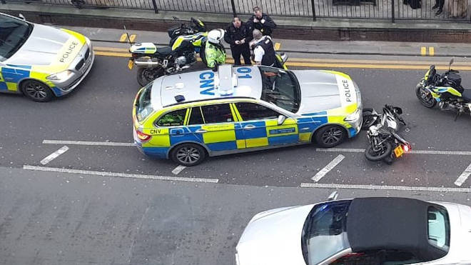 The police car nudged the thief while other officers chased him