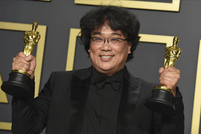 Bong Joon-ho celebrates after winning Best Director and Best Picture for Parasite