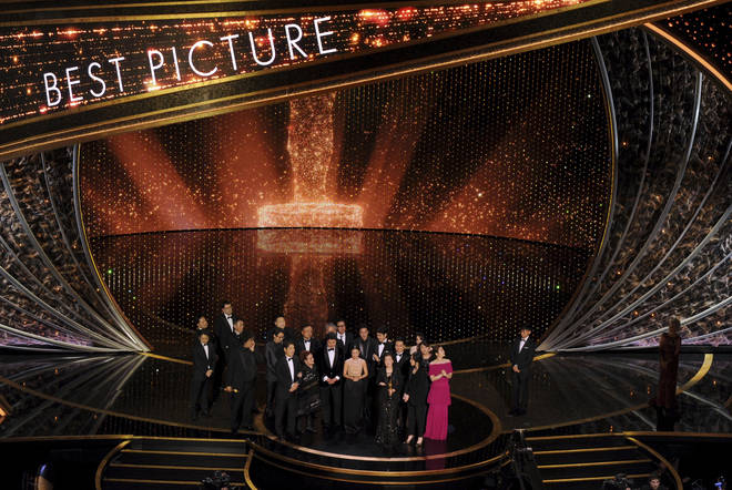 The cast gather to accept their award
