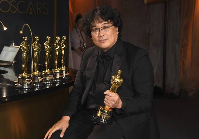 The award winner beams as his Oscar is engraved