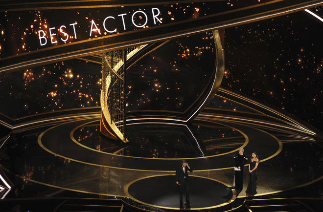 He takes to the stage after winning the Oscar