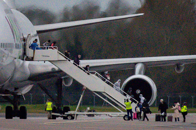 Britons are seen arriving off a flight from Wuhan, China, the epicentre of the outbresk