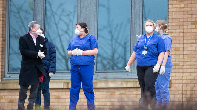 NHS staff prepare to greet travellers from Wuhan