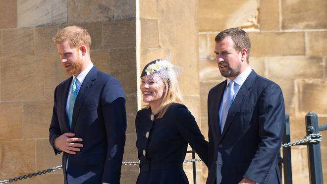 The couple with Prince Harry (left) at church last year
