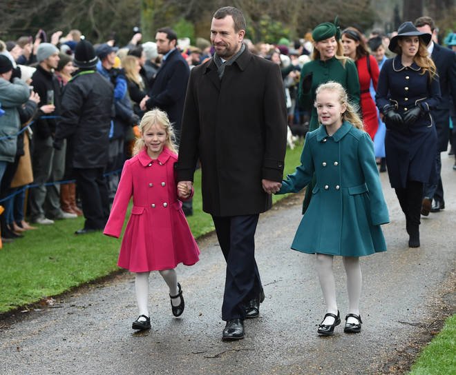 Peter pictured with the couple's daughters, Savannah and Isla