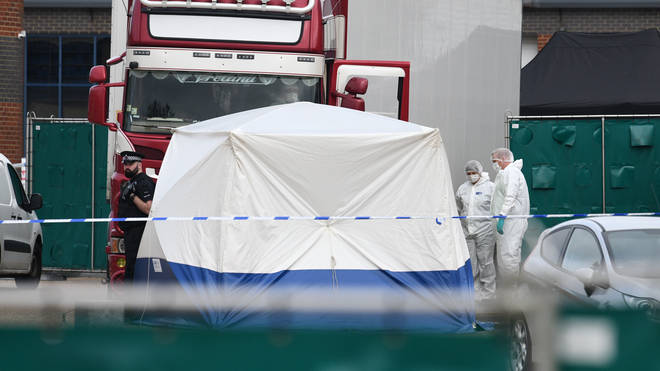 Police and forensic officers investigate the site where 39 bodies were discovered in the back of a lorry on October 23, 2019