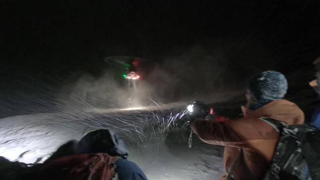 The group were airlifted to hospital after becoming trapped in blizzard conditions