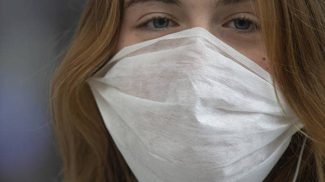 Can face masks really protect us from coronavirus? Experts reveal all
