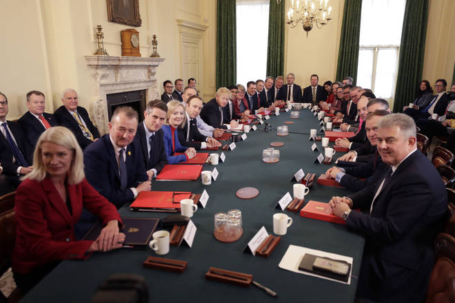 Boris Johnson poses with his new look Cabinet